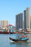 Traditional Chinese fishing junk in Victoria Harbor, Hong Kong - stock photo