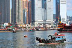 Traditional Chinese fishing junk in Victoria Harbor, Hong Kong Stock Photos