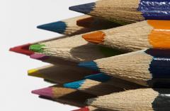 Multicolored pencils arranged background - stock photo