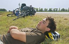 Tired cyclist Stock Photos