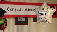 Stock Video Footage of Congratulation class of 2014 balloon and banner