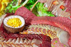 Meat  on banquet table in buffet Stock Photos