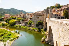 Medieval stone bridge over Fluvia river in Besalu Stock Photos