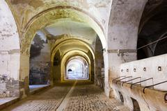 Stables in the dungeon of the abandoned castle - stock photo