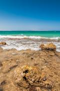 beautiful azure red sea with waves and rocks in egypt - stock photo