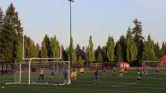 Young grils practicing soccer inside sport field Stock Footage