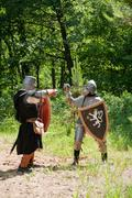 knights in armor is fighting - stock photo