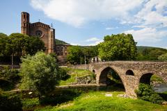 Old church and medieval bridge - stock photo
