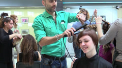 Professional hairdresser create hairstyles for model Stock Footage