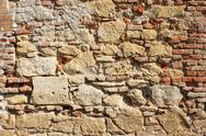 Stock Photo of ancient exterior fortress wall built with rocks and bricks, texture
