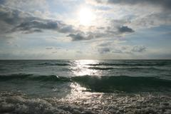 spindrift wave in morning and sun shine - stock photo