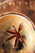 A cup of spiced coffee with anis star macro Stock Photos