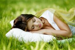 Woman sleeping on grass Stock Photos