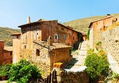 Picturesque stony houses in ordinary spanish town Stock Photos