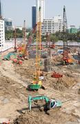 truck backhoe soil excavation and soil movement in construction site. - stock photo
