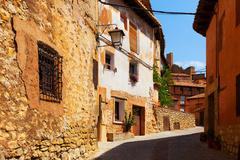 Sunny street of  spanish town in summer Stock Photos