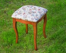 convenient stool with the seat upholstered with a gobelin. - stock photo