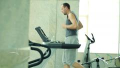 Man running on the treadmill at the gym  HD Stock Footage