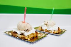 Two delicious desserts topped with ice cream Stock Photos