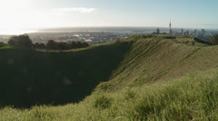 tourists on Mt Eden above Auckland CBD - stock footage