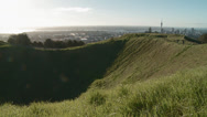 Stock Video Footage of tourists on Mt Eden above Auckland CBD
