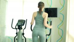 Woman exercising cardio on the elliptical machine in the gym HD Stock Footage