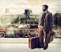 Emigrant to the train station with cardboard suitcases - stock photo