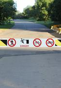 Road Gate with Danger and Interdiction Signs - stock photo