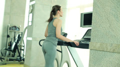 Woman running on the treadmill in the gym  HD Stock Footage