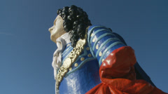 MOVING SHOT - Ship figurehead with Spinnanker Tower, Portsmouth Stock Footage