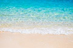 Tropical white sand beach and blue sea wave Stock Photos