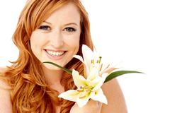 Beauty woman holding lily flower - stock photo