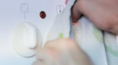 Cleaning Oven Turning Buttons Stock Footage