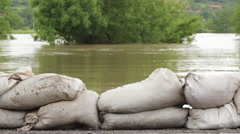 Flood defense. Retaining wall made by stacking sandbags for floods protection. Stock Footage
