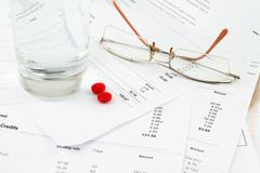 Bills and glasses Stock Photos