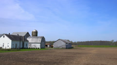 Driving by a small rural farm along a country road. Stock Footage