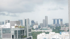 4k Ultra HD time lapse video of skyline on a drizzling day, Singapore(TLSGSKL21) Stock Footage