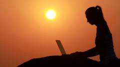 Girl working with laptop Stock Footage
