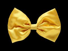 Gold satin gift bow. ribbon. isolated on black with clipping path Stock Photos