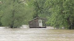 Flooded wooden house. Damaged hut after big storm and floods. Natural disaster. - stock footage