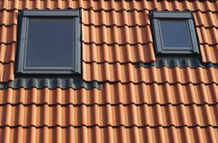 Dormers on a tiled roof Stock Photos
