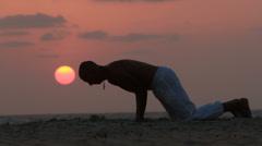 Man doing Yoga Stock Footage