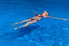 woman is relaxing in swimming pool - stock photo