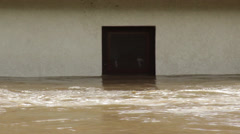 Flooded house. Environmental disaster. Damaged home after big floods. Close up. - stock footage