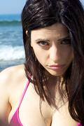 Portrait of sad funny woman making strange face on the beach Stock Photos