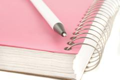 ring binder and pen - stock photo