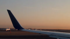 Plane is steers at the takeoff runway of the JFK . View from the  illumin Stock Footage
