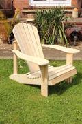 A handmade Adirondack style chair Stock Photos