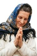 Stock Photo of old age praying woman on white background