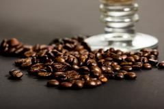 Coffee beans and capuccino cup - stock photo